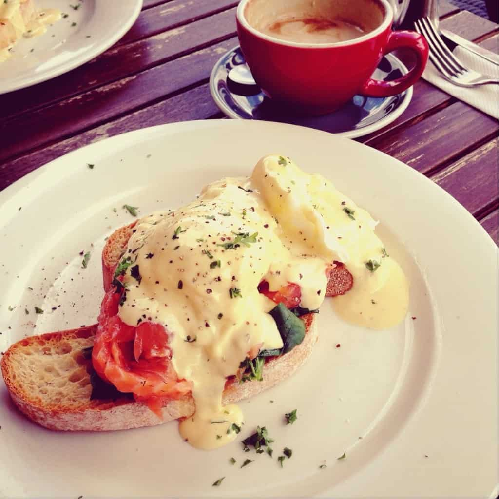 Eggs Benedict with salmon, spinach, hollandaise and a sprinkling of herbs - as served at Cafe Cinema, Kerikeri.
