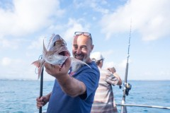 Clint-shows-off-a-good-size-snapper-that-someone-just-snagged