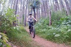 Cornelia-cycling-through-the-Waitangi-Mountain-Bike-Park